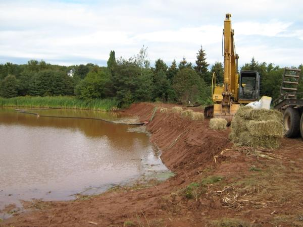 Excavation of silt from Bernards Pond